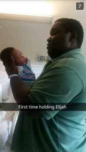 jerome-holds-elijah-for-first-time